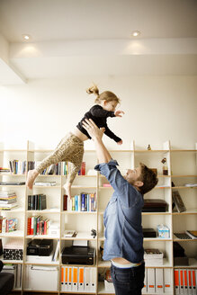 Father playing with daughter at home - CAVF00408