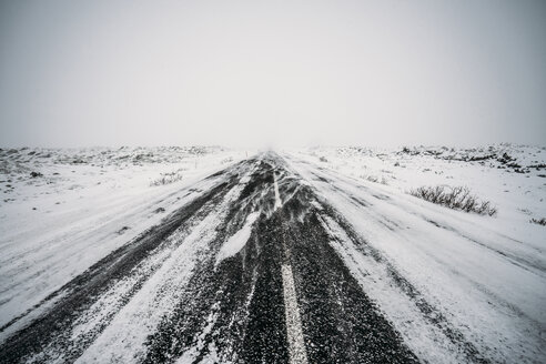 Diminishing perspective remote snow covered road - CAIF04742