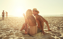 Young couple relaxing on sunny summer beach - CAIF04793