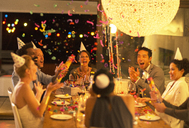 Friends throwing confetti at birthday party - CAIF04857