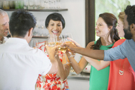 Friends toasting each other at party - CAIF04872