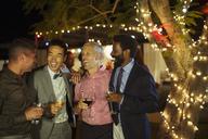 Men talking at party - CAIF04881