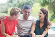 Friends relaxing together outdoors - CAIF04905
