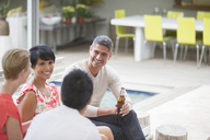 Friends talking at party - CAIF04911