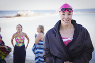 Portrait smiling, confident female open water swimmer - CAIF05228