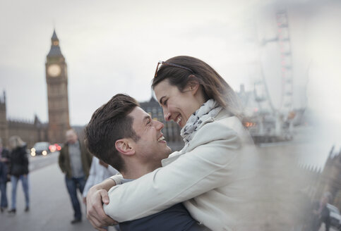 Romantic, affectionate couple tourists hugging near Big Ben, London, UK - CAIF05246