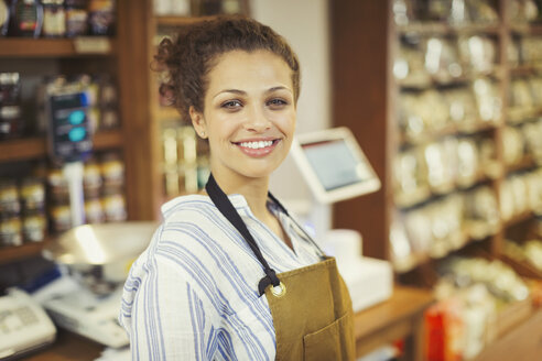 Portrait smiling, confident female worker in grocery store - CAIF05261