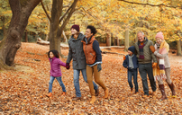 Multi-generation family walking in autumn park - CAIF05441