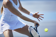 Female tennis player playing tennis, holding tennis racket - CAIF05819