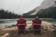 Canada, British Columbia, Yoho National Park, two men resting at Yoho Lake - GUSF00419