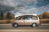 Canada, British Columbia, man with minivan on Alaska Highway - GUSF00443