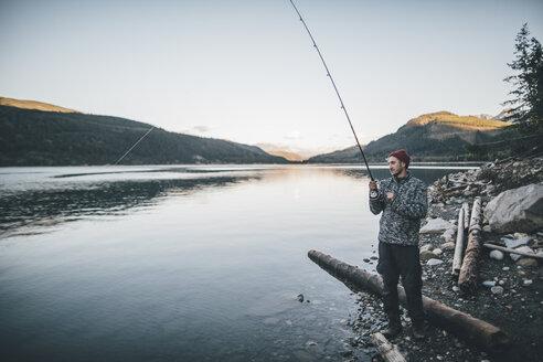 Canada, British Columbia, man fishing at Kinbasket Lake - GUSF00449