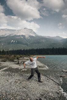 Canada, British Columbia, Yoho National Park, man skipping stones at Emerald Lake - GUSF00458