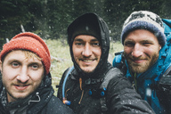 Canada, British Columbia, Yoho National Park, selfie of three smiling hikers in snowfall - GUSF00467