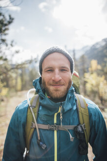 Canada, British Columbia, Mount Robson Provincial Park, portrait of smiling hiker - GUSF00476