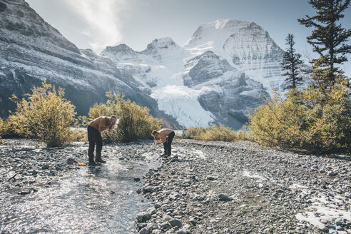 Canada, British Columbia, Mount Robson Provincial Park, two men washing in a brook - GUSF00479
