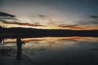 Canada, British Columbia, man fishing at Duhu Lake at sunset - GUSF00488