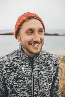 Canada, British Columbia, portrait of smiling man at Boya Lake - GUSF00506
