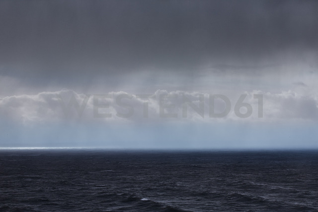 Clouds and rain over ocean seascape - CAIF05918
