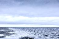 Rippling ocean surf under overcast sky - CAIF06023