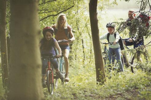 Family mountain biking in woods - CAIF06053