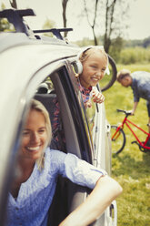 Happy mother and daughter in car - CAIF06095