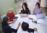 Business people talking, working at laptops in conference room meeting - CAIF06182