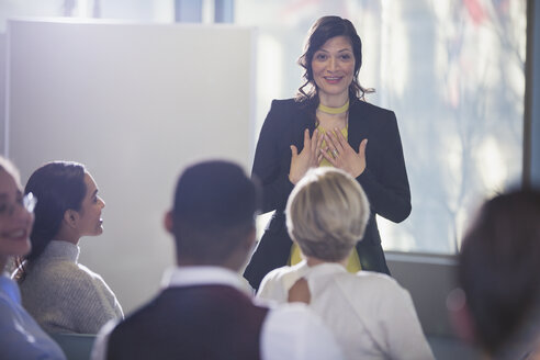 Businesswoman gesturing, leading conference meeting - CAIF06191