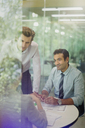 Attentive businessmen in conference room meeting - CAIF06221