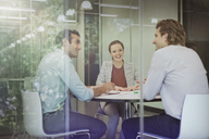 Business people talking in conference room meeting - CAIF06233