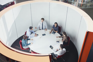Business people meeting in round open plan conference room - CAIF06248