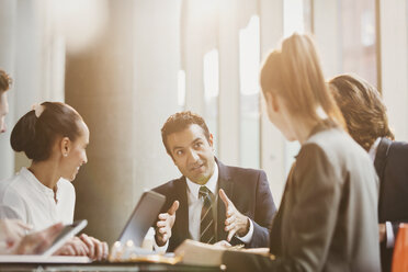 Businessman talking, leading conference room meeting - CAIF06275