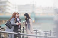 Business people drinking coffee and talking on urban ramp - CAIF06302