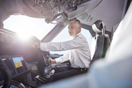 Smiling male pilot in airplane cockpit - CAIF06586
