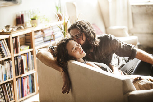 Couple relaxing on sofa at home - CAVF01157