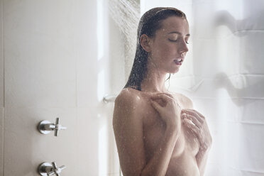 Sensual woman covering breast while taking shower in bathroom - CAVF01277
