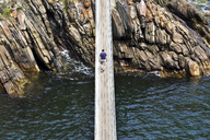 Africa, South Africa, Western Cape, Paarl, Garden Route National Park, Tsitsikamma National Park, man walking on wooden bridge - FPF00151
