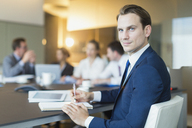 Portrait confident businessman in conference room meeting - CAIF06721