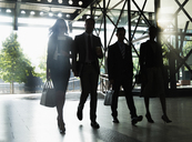 Corporate business people walking outside building - CAIF06793