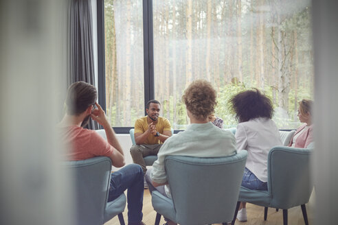 Man talking in group therapy session - CAIF06865