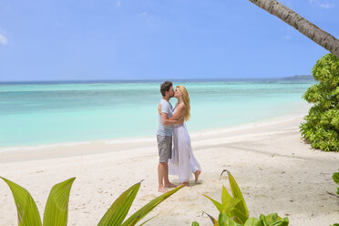 Happy couple kissing on the beach - ZEF15169