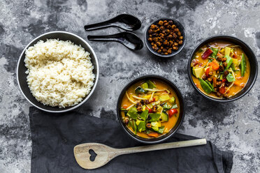 Red curry in bowls, rice and roasted chickpeas - SARF03598