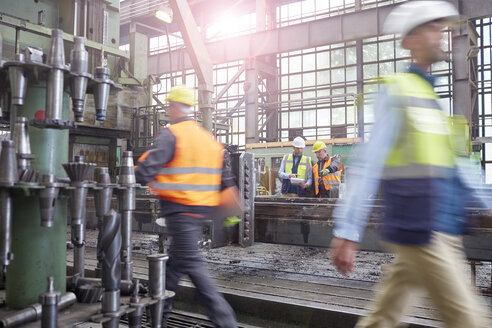 Workers walking and meeting in factory - CAIF07243
