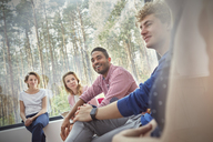 Smiling people listening in group therapy session - CAIF07489