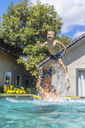 Father and son having fun in swimming pool - KNTF01095