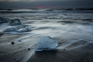 Ice on stormy cold ocean beach, Iceland - CAIF07508