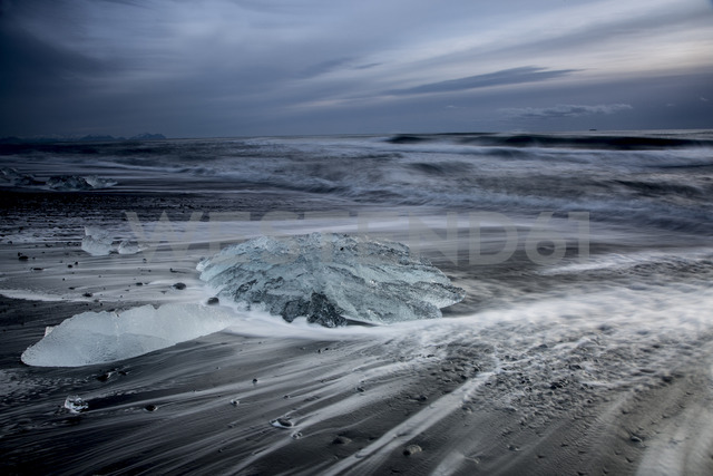 Ice on stormy cold ocean beach, Jokulsarlon, Iceland - CAIF07526