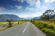 Rural road through scenic Lake District, Ullswater, Cumbria, England - CAIF07583