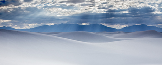Sunbeams over tranquil white sand dunes, White Sands, New Mexico, United States - CAIF07589