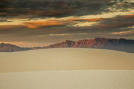 Dramatic sunset sky over sand dunes and mountains, White Sands, New Mexico, United States - CAIF07592